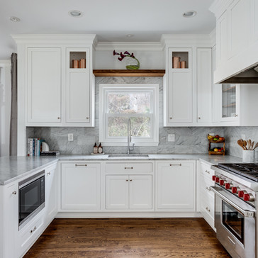 A modern light and bright kitchen with wood accents ddesigned by Erika Jayne Design, a Maryland based interior design firm serving the Washington, DC area.