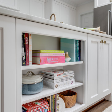 Open shelving in a white kitchen designed by Erika Jayne Design, a Maryland based interior design firm serving the Washington, DC area.