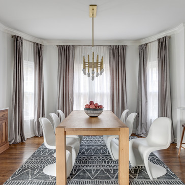 A modern chic dining room with wood and gold accents designed by Erika Jayne Design, a Maryland based interior design firm serving the Washington, DC area.