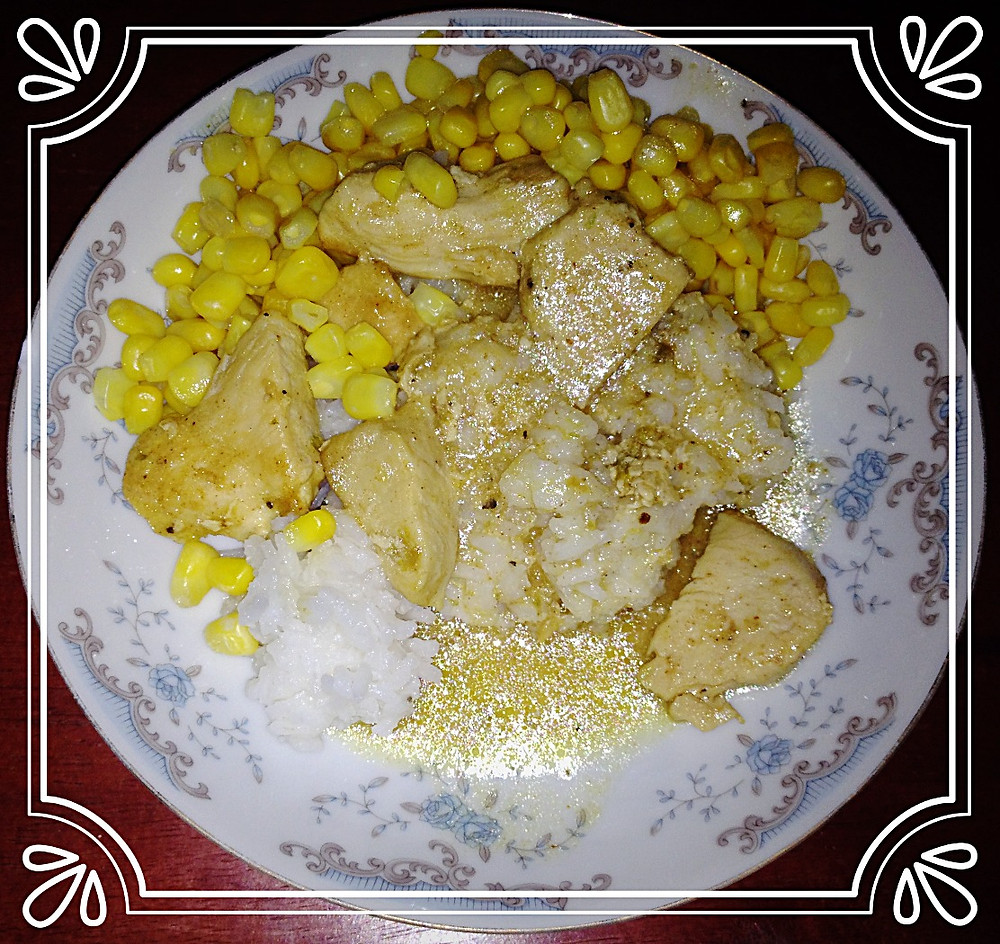 Lighter Chicken Diane with rice and corn.