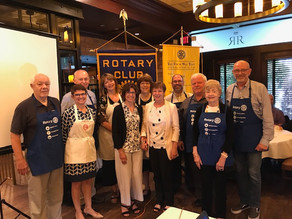 The Rotary team in aprons planning to feed the Walk In Shelter for Family Promise