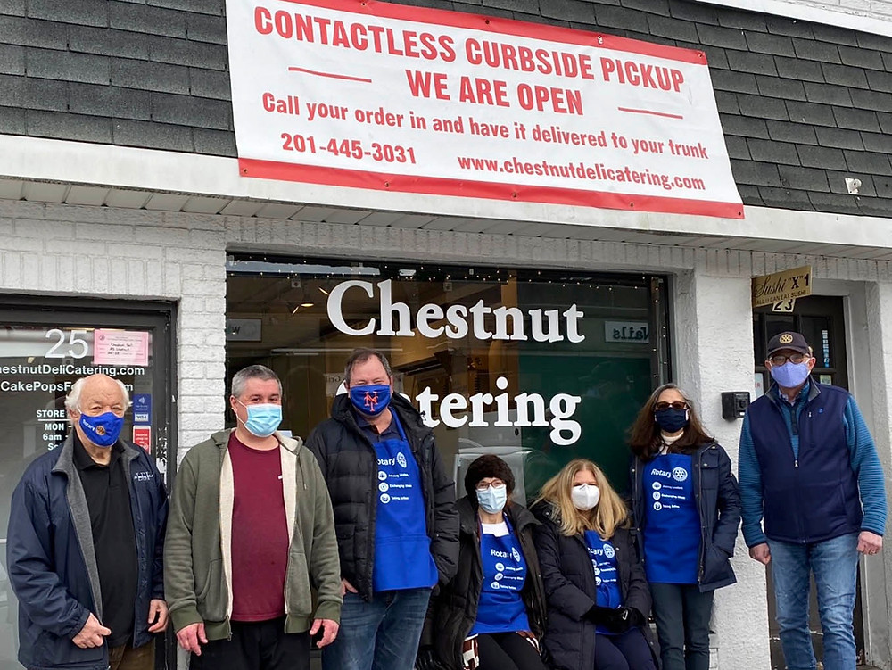 Ridgewood AM Rotary Club members in front of Chestnut Deli