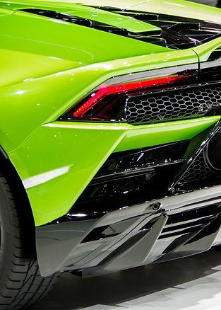 Shiny green sports car body tail light a