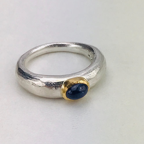 Blue cabochon sapphire sand cast ring