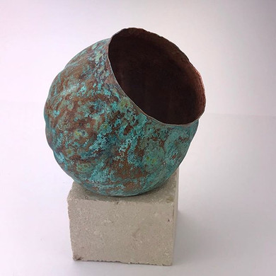 Hand raised and chased patinated copper