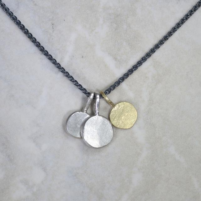 Sun and Moon pendants grouped