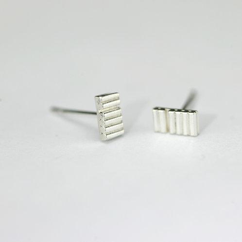 Tiny bar studs