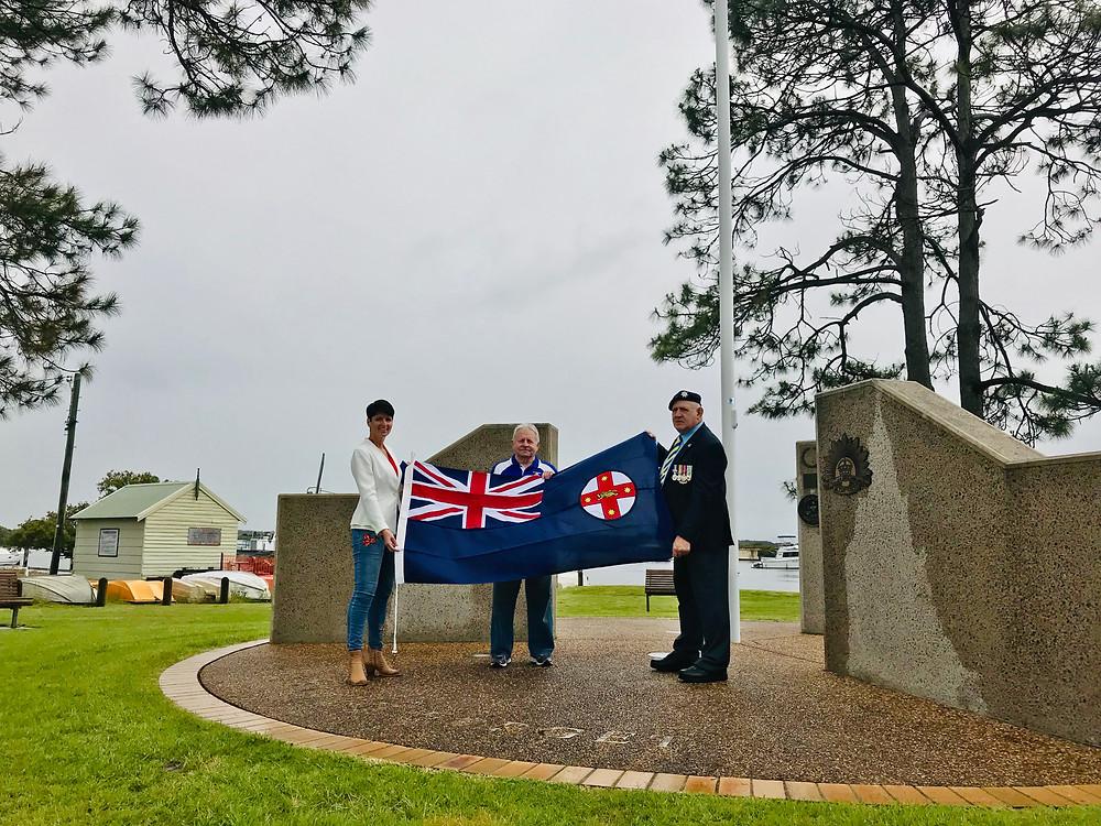 Kate Washington presenting NSW Flag to Tea Gardens RSL