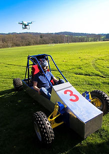 Buggy and drone on field
