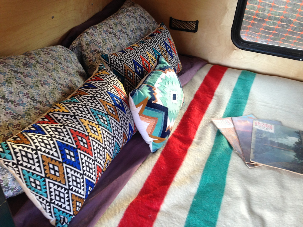 Cozy 6 inch thick mattress with pillows and Hudson's Bay wool blanket in a Road Runner Model.
