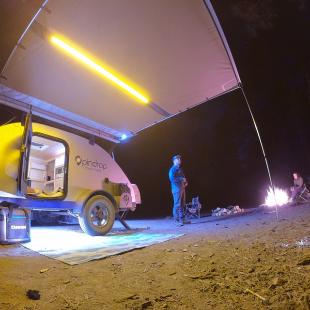 Showing all indoor and exterior lighting of a Pin Drop Travel Trailer