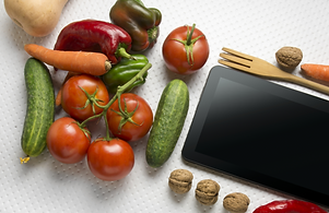 Digital%20tablet%20with%20fresh%20vegetables%20on%20white%20background_edited.png