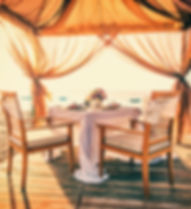 Romantic dinner setting on the beach at