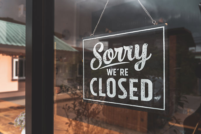 _ Sorry we're closed _ sign in black and white, on shop glass door..jpg