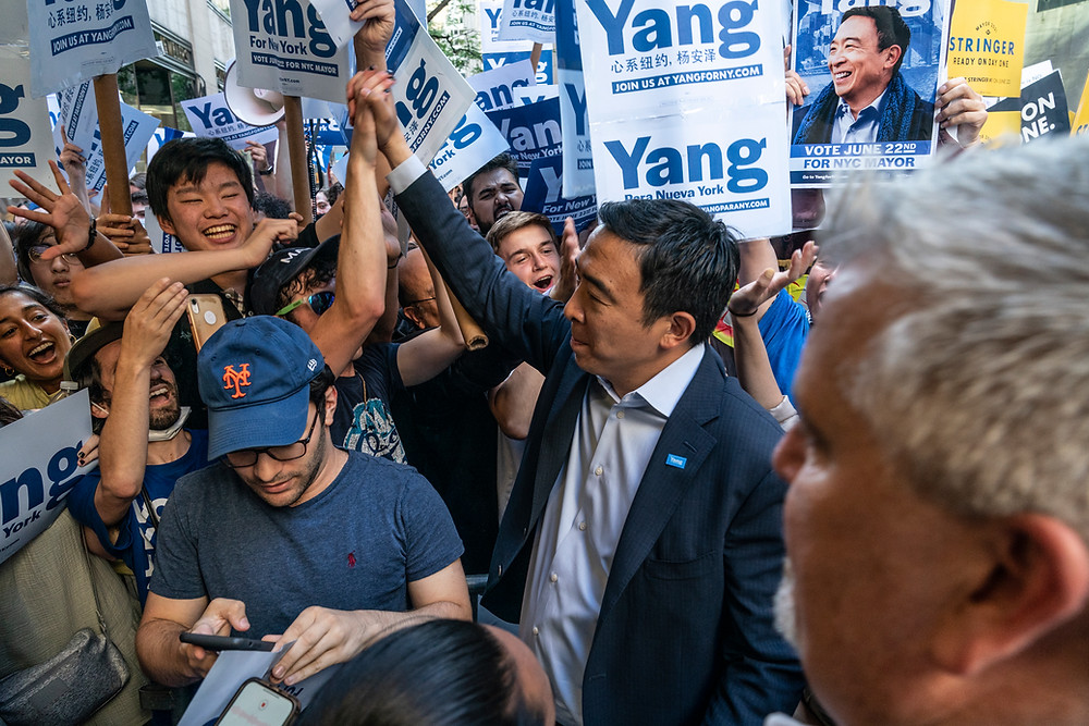 New York, NY - June 16, 2021: Mayoral candidate Andrew Yang arrives for debate at NBC Studios at Rockefeller Center. Supporters gather outside awaiting his greeting, Yang appreciates their support Photo Credit: Devin Kasparian / TALS Studio
