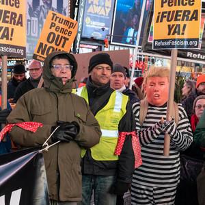 Few dozens of protesters rally agianst President Donald Trump