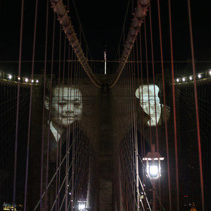 New York City Honors Lives Lost To COVID-19 On Anniversary Of First Death NEW YORK, NY - MARCH 14: Images of New Yorkers lost to the COVID-19 pandemic are projected on to the Brooklyn Bridge on March 14, 2021 in New York City. New York City honors lives lost to COVID-19 on the anniversary of the one year anniversary of the COVID-19 lockdown. (Photo by Yoni Levy / Tals Studio )