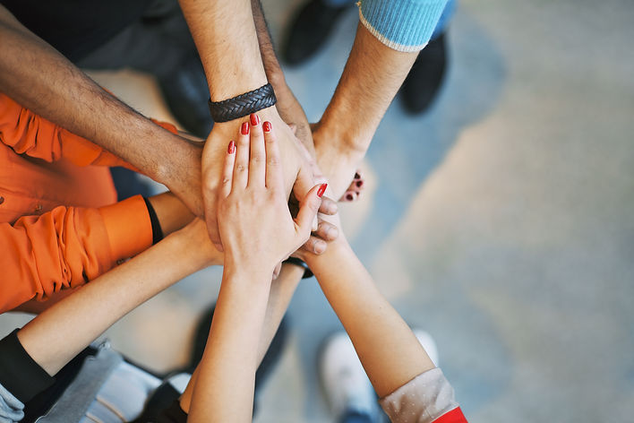 Multiethnic group of hands clasped together