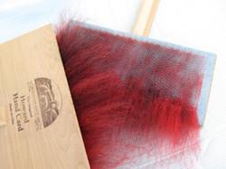 Carding red cheviot & black Newf fur