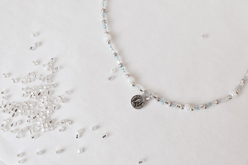 Pale blue coin necklace