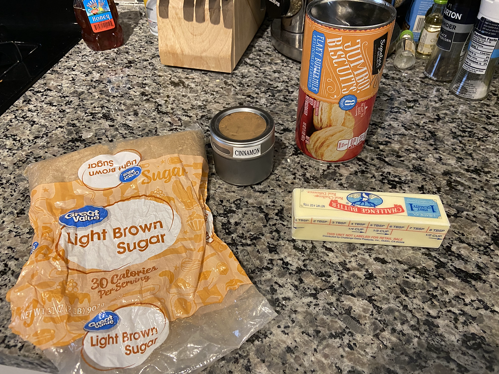 brown sugar, cinnamon, store-bought biscuits, butter