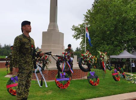 Canadian soldiers salute at Groesbeek War Cemetery