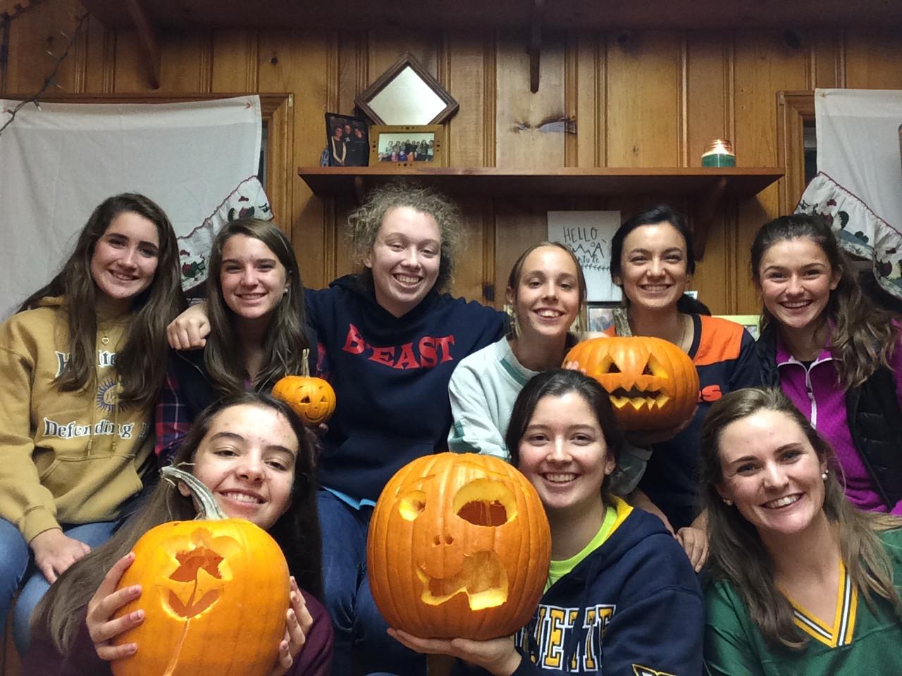 HS girls carving pumpkins.jpg