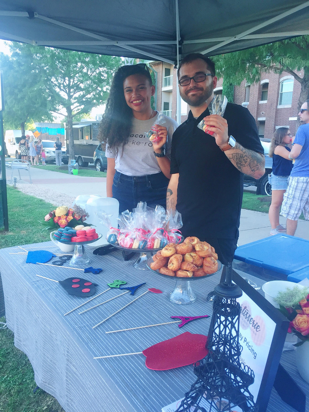 Our team serving macarons at Triangle Park