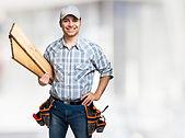 portrait-smiling-carpenter-holding-wood-
