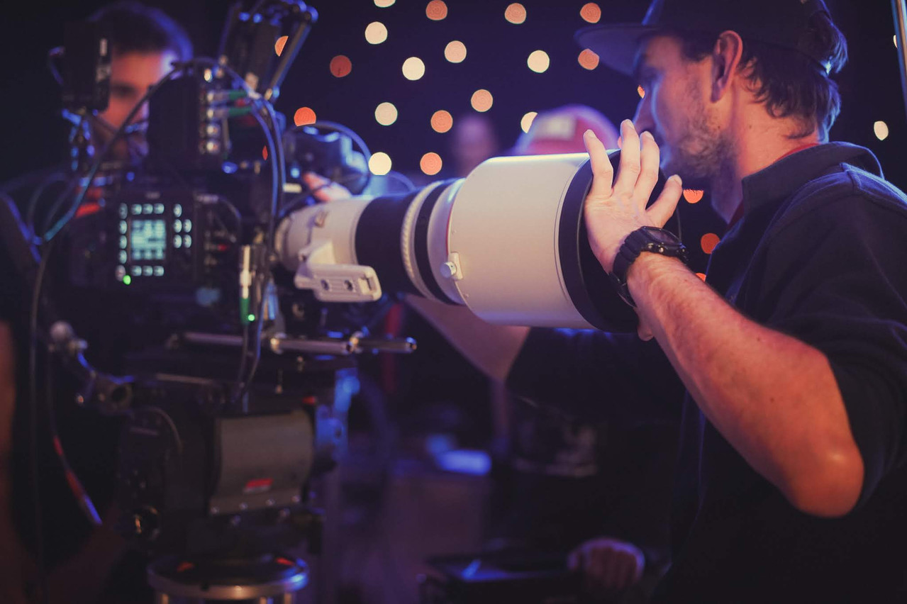 1st AC, Joel Schaffer swapping 400mm on Canon C700