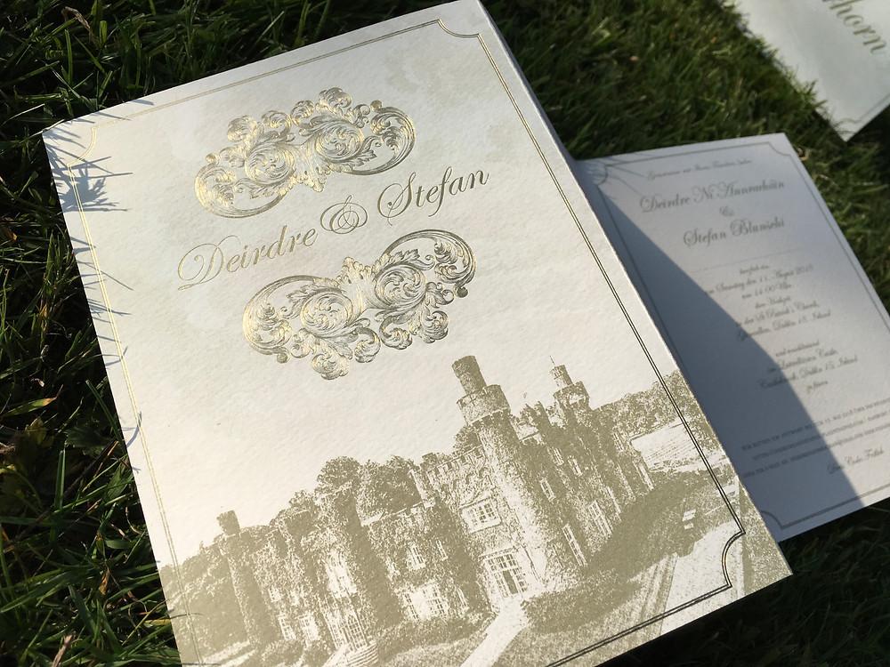 gold foil letterpress invitation with venue illustration