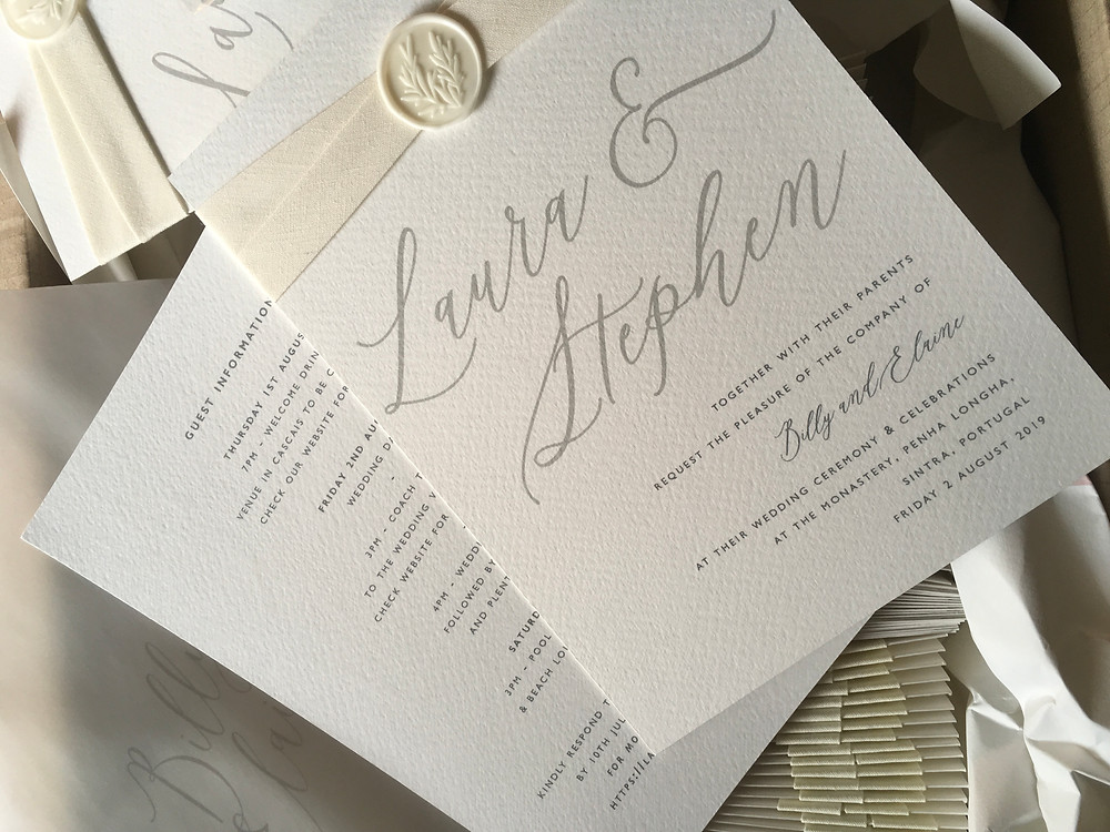 Calligraphy invitation with wax seal and vellum envelope
