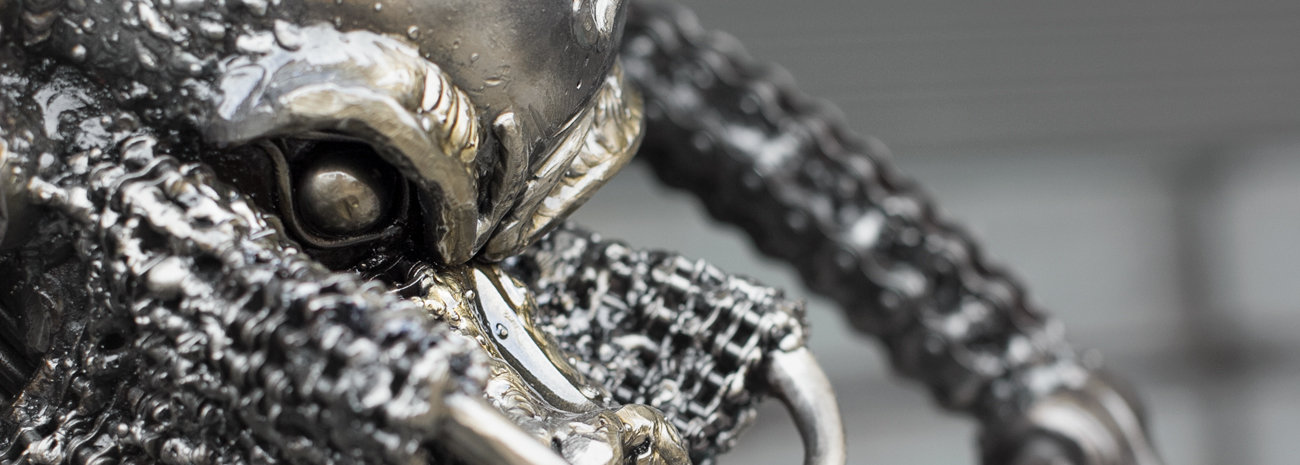 Predator metal sculpture face