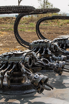 Scorpion chairs scrap metal artwork