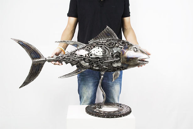 Fish metal sculpture made from scrap metal, size compare
