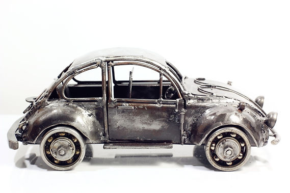 Vintage folk car model sculpture made from scrap iron right 2