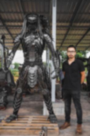 predator metal sculpture compare size