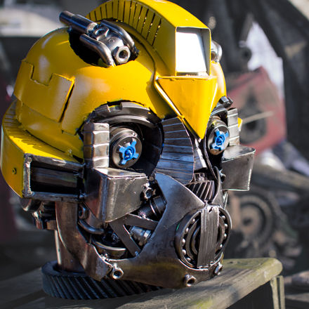 Metal art transformer head