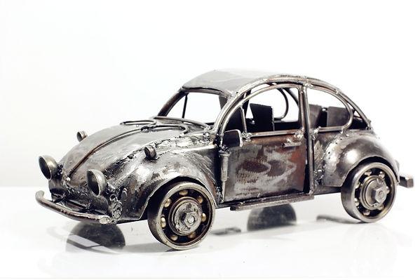Vintage folk car model sculpture made from scrap iron left.