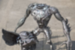 recyecled metal art sculpture gremlin monster , take head a part