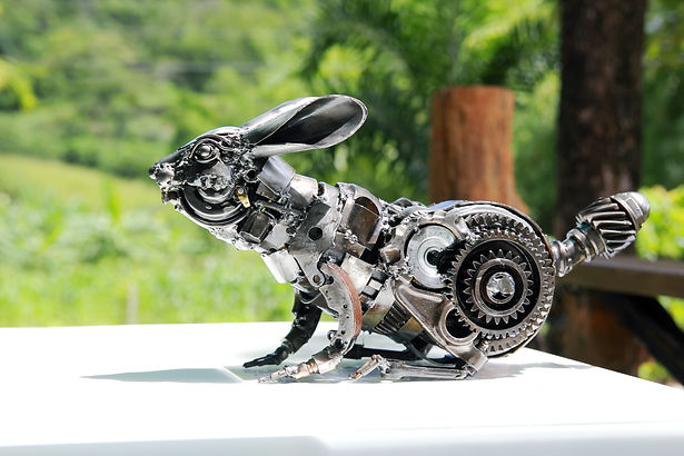 Rabbit scrap metal art sculpture, left