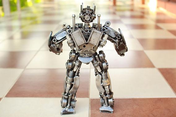 30cm optimus prime scrap metal sculpture behind
