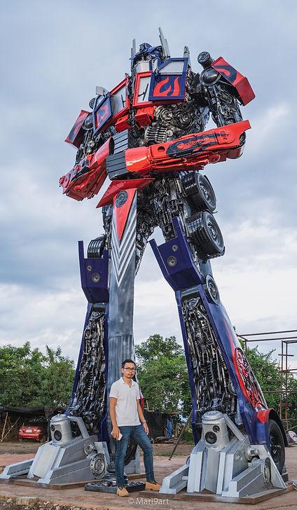 scrap metal large sculpture transformer compare size