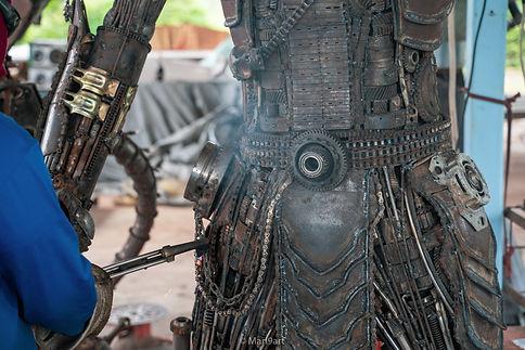 burning process making predator sculpture