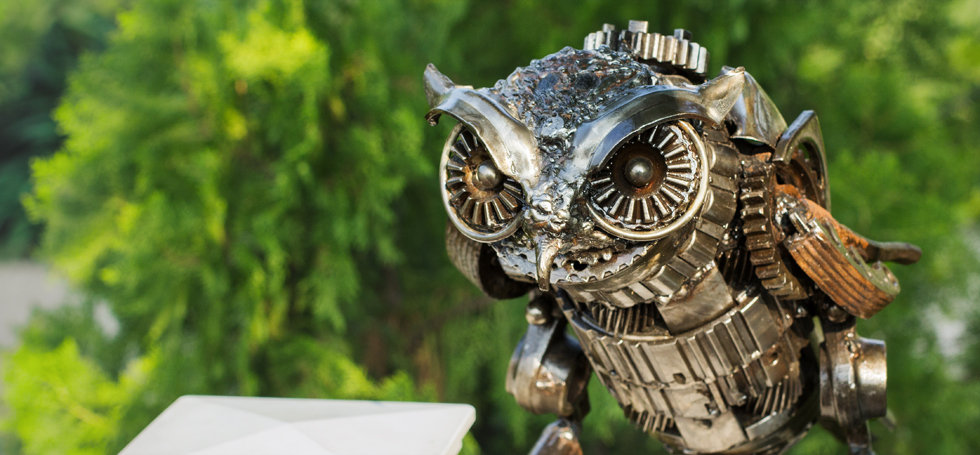 Metal owl sculpture made from junk steel
