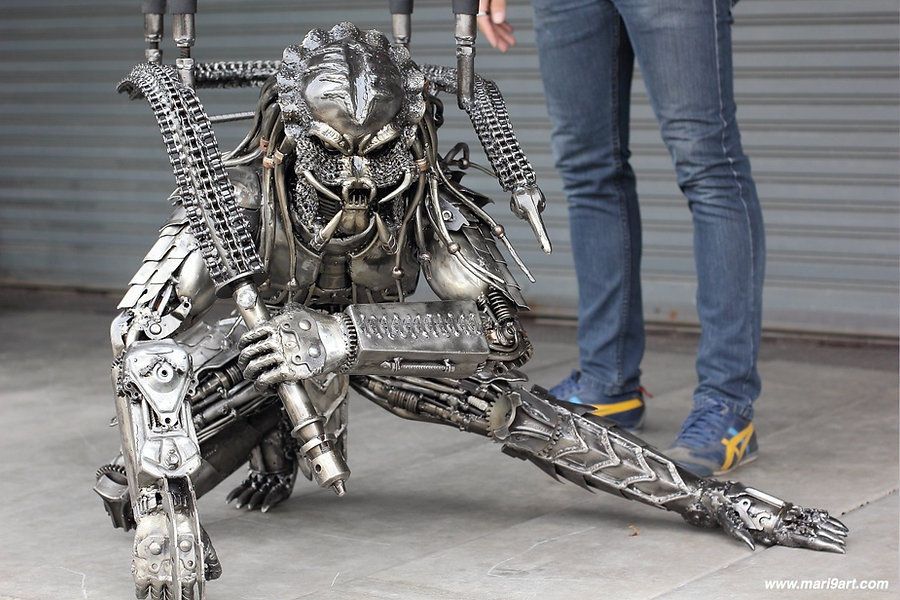 Predator metal artwork made of recycled engine and scrap metal size compare