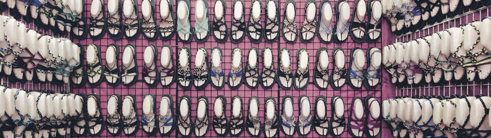 Multi-color flat sandals in store.