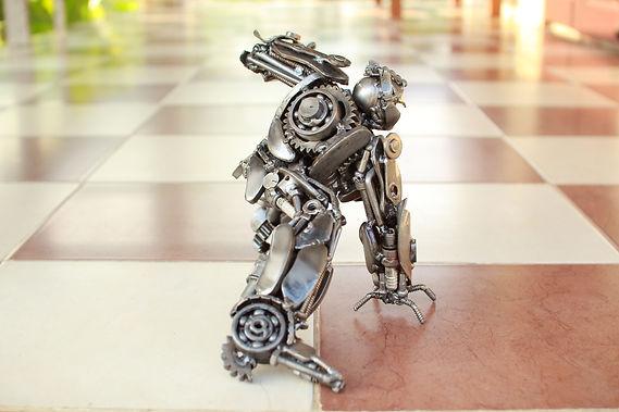 Beside optimus prime scrap metal sculpture zoom head