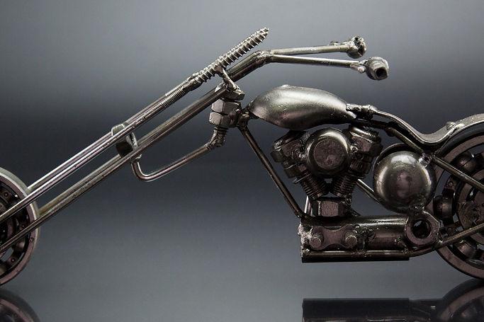 Ape chopper bike model scrap sculpture made from scrap steel.