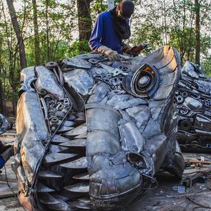 Dinosaur trex scrap metal sculpture